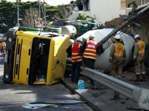 Top-heavy cement trucks frequently overturn, putting people at risk.