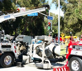 An overturned cement truck on Sunset injured three and blocked traffic for hours.